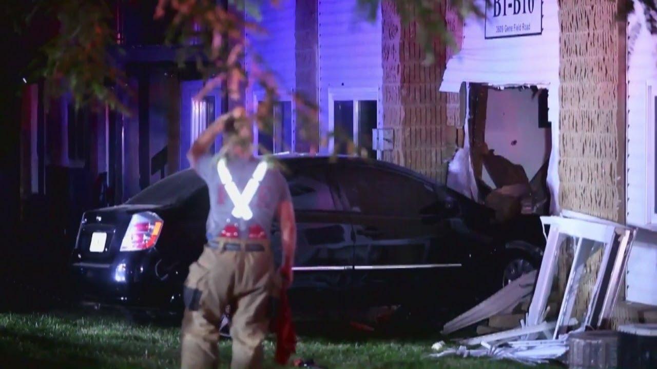 car-crashes-into-apartment-building